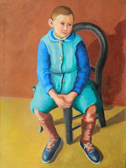 Enfant-assis-au-costume-vert-et-bleu,-Copyright-ADIN,-photo-Olivier-Goulet